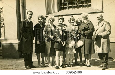 LODZ, POLAND, SEVENTIES - Vintage photo of little boy with his family at his First Communion