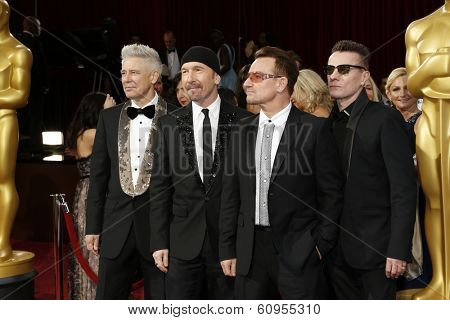 LOS ANGELES - MAR 2:: The Edge, Adam Clayton, Bono, Larry Mullen Jr.  at the 86th Annual Academy Awards at Hollywood & Highland Center on March 2, 2014 in Los Angeles, California