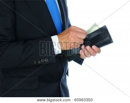 Closeup of a businessman wearing a dark suit taking money from his wallet.  Horizontal format over a white background only showing the mans torso and hands.