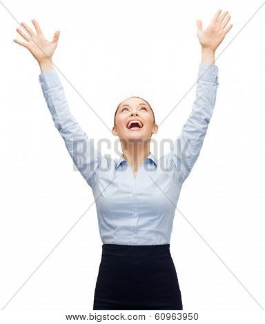 business, success and office concept - laughing businesswoman waving hands