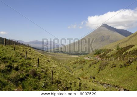 Mountain Beinn Dorain Scotland Highlands with a cloud over it