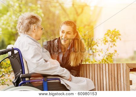 Young woman is visiting her grandmother in nursing home