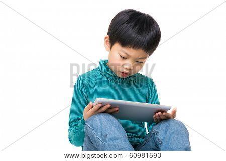 Asia little boy using tablet