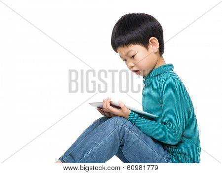 Asian little boy using tablet