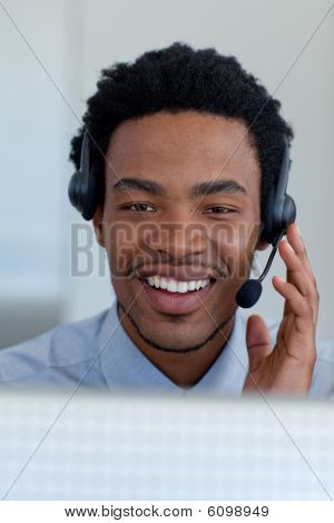 Afro-American young businessman working in a call center poster