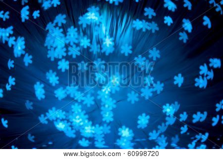 snowflakes shaped bokeh pattern - abstract winter background
