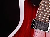 Closeup of red electric guitar neck, strings and pickup poster