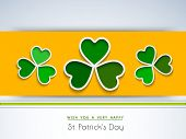 Happy St. Patrick's Day celebrations flyer, banner or poster design with beautiful green Irish lucky shamrock leaves on yellow and blue background.  poster