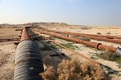 Oil and gas pipeline in the desert of Bahrain Middle East poster