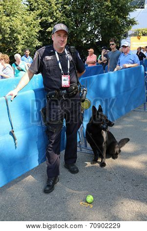 NYPD transit bureau K-9 police officer and Belgian Shepherd K-9 Taylor providing security at US Open