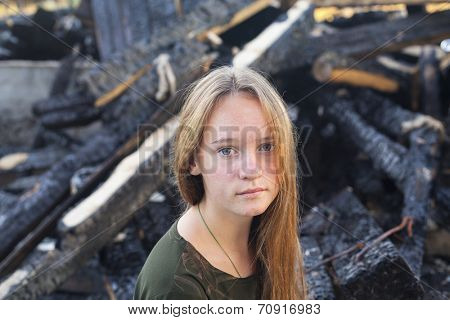 Portrait of a beautiful girl, coals after the conflagration on a background.