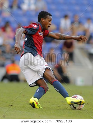BARCELONA - AUG, 17: Edenilson of Genoa CFC in action during a friendly match against RCD Espanyol at the Estadi Cornella on August 17, 2014 in Barcelona, Spain