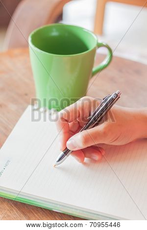 Writing Important Note In Coffee Shop