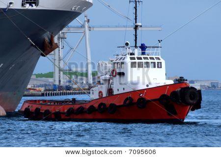 Tugboat At Work A