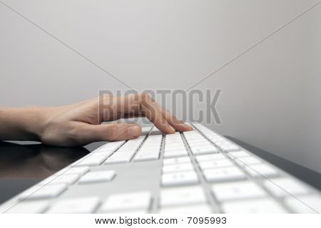 Womans Hand On Flat White Keyboard Typing
