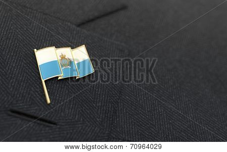 San Marino Flag Lapel Pin On The Collar Of A Business Suit