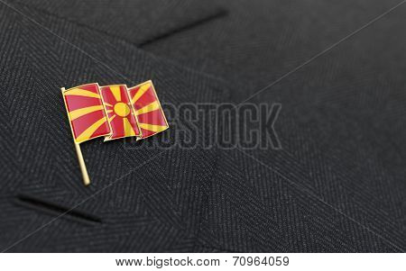 Macedonia Flag Lapel Pin On The Collar Of A Business Suit