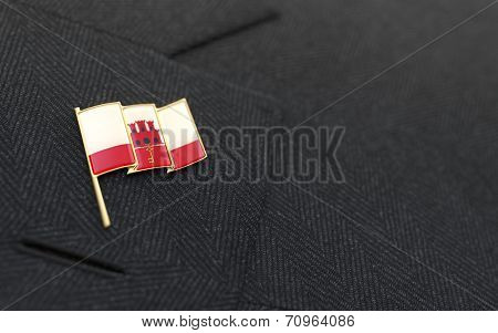 Gibraltar Flag Lapel Pin On The Collar Of A Business Suit