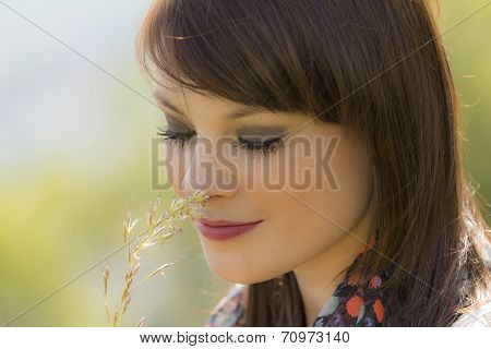 Beautiful Happy Girl Is In Love With Nature