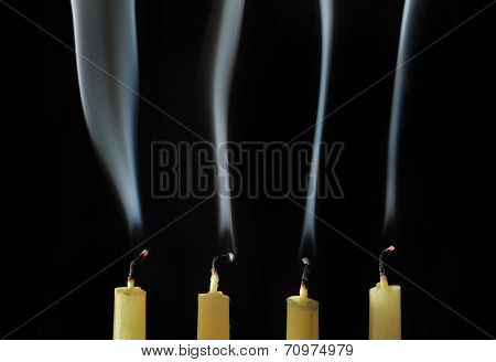 Extinguished candles with smoke