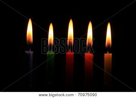 burning five colors candles