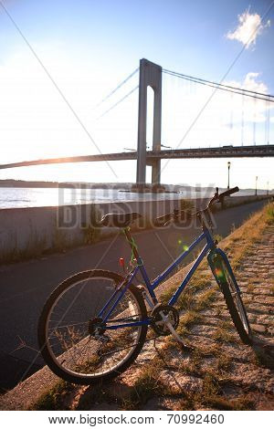 Bicycle close to the Verrazano-Narrows Bridge , The largest and longest bridge in New York City poster