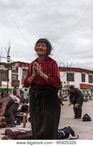 Praying Old Tibetan Woman
