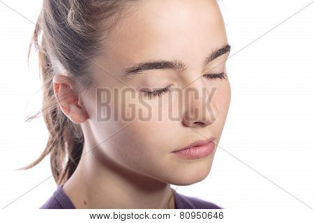 Portrait Of A Teenage Girl With Closed Eyes, Isolated On White