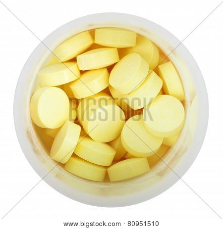 Yellow Pills In Round Plastic Bottle Close Up