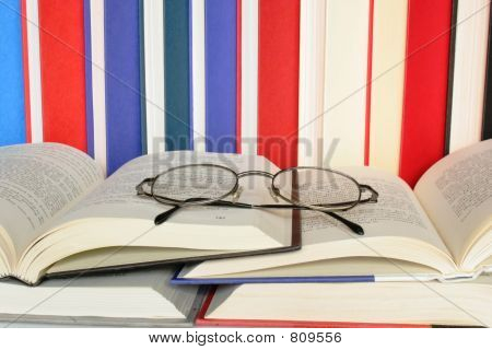 Eyeglasses on Open Books