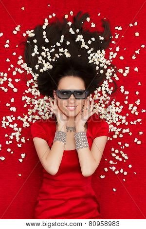Girl with 3D Cinema Glasses and Popcorn Watching a Movie