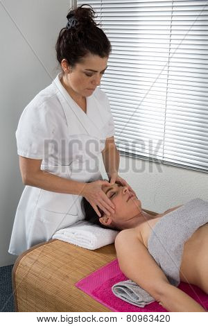Therapist Woman Doing Massage On A Woman's Head