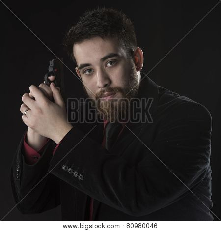 Young Agent in Black Suit Holding Pistol