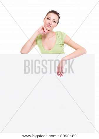 Beautiful Woman Under The White Blank Billboard