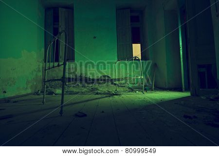 Light Painted In Green Abandoned Bed In Dark Room. Halloween Party Background