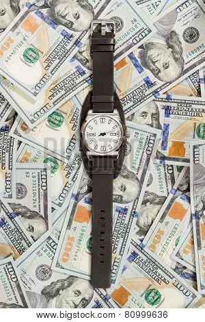 Wrist watch on money background