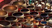 Several singing bowls displayed at a market in Kathmandu Nepal poster
