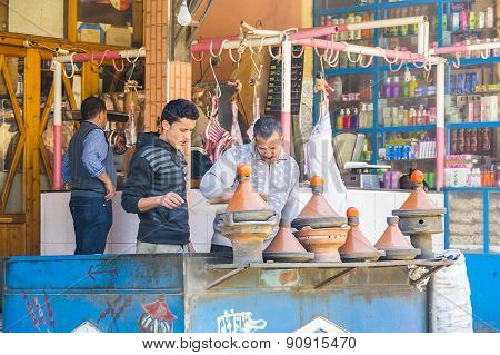 TADDERT, MOROCCO, APRIL 15, 2015: Local cooks prepare traditional tagines in front of the restaurant