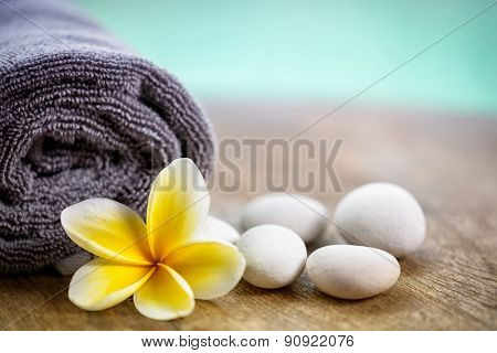 White frangipani on towel in the spa, close up