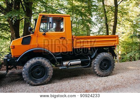 Unimog Four Wheel Drive Vehicle As Seen On A Forest Road.