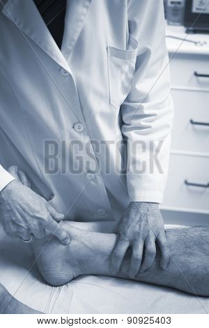 Traumatologist orthopedic surgeon doctor examining middle aged man patient to determine injury pain mobility and to diagnose medical treatment in leg knee meniscus cartilage ankle and foot injury. poster