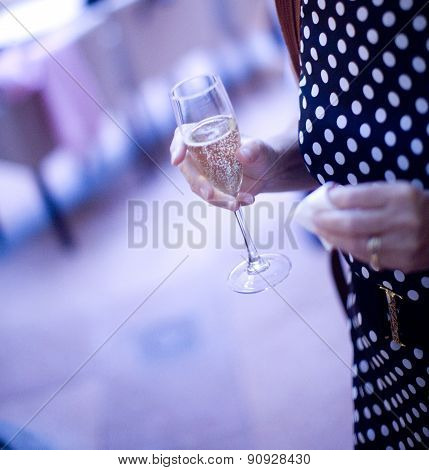 Champagne Flute Wine Glass In Hand Of Wedding Guest