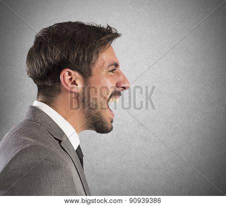 Businessman explodes in a scream