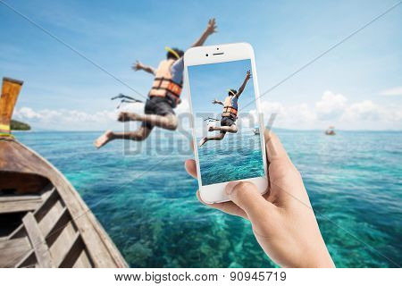 Taking Photo Of Snorkeling Divers Jump In The Water.