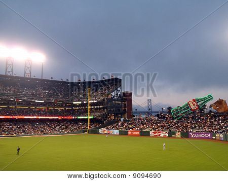 Dodger Oufielders Stand In Between Plays At On A Foggy Night At Att Park