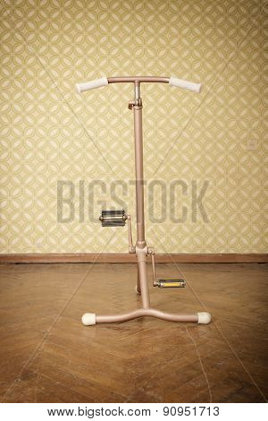 vintage stationary bicycle is in retro room. velosimulator