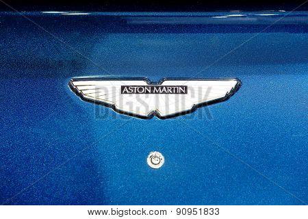 Logo Of Aston Martin On Blue Bonnet