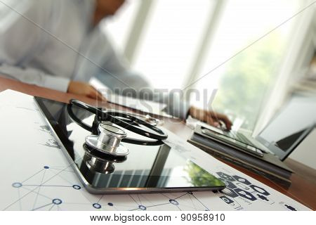 Doctor Working With Laptop Computer In Medical Workspace Office And Medical Network Media Diagram As