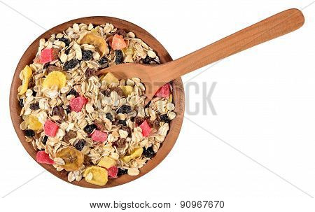 Musli In A Wooden Bowl On A White