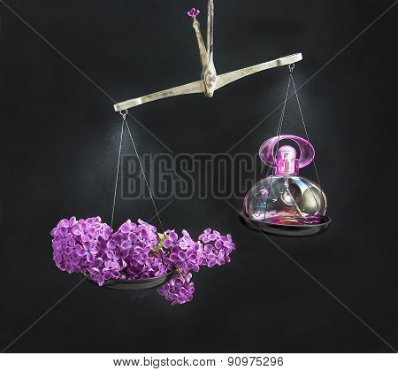 Natural And Lilacs Perfume Bottle On Opposing The Scales.